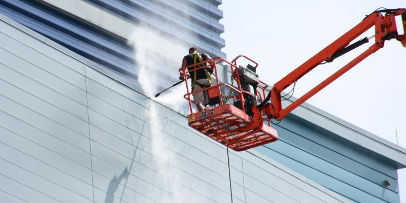 Power washing on a lift.