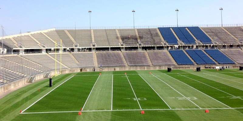 In-progress shot of power washing Rentschler Field.